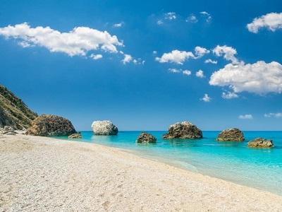 Megali-Petra-Beach-Lefkada-Island-Greece.-A-beautiful-beach-with-large-rocks-in-the-water.-min
